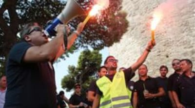 Greeks protest 'last' austerity cuts