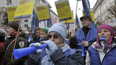 State employees are angry about a plan to lay off workers and cut wages by some 5 percent this year [Reuters]