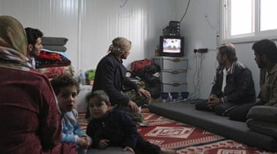 Syrians in and outside the country watched the speech, Assad's first in months [Reuters]