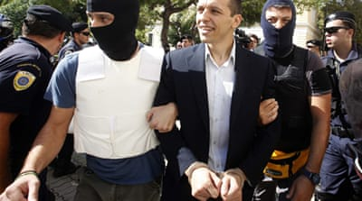 Greek neo-Nazi MPs face court charges