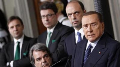 Enrico Letta accused Silvio Berlusconi of attempting to topple his government [AFP]