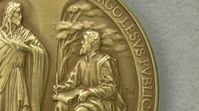 "A Latin inscription around the edge of the medals referred to ""Lesus"" [Al Jazeera]"