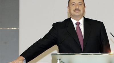 Ilham Aliyev (right) took over Azerbaijan's presidency in 2003 after his father, Hyder Aliyev (left), died [AP]