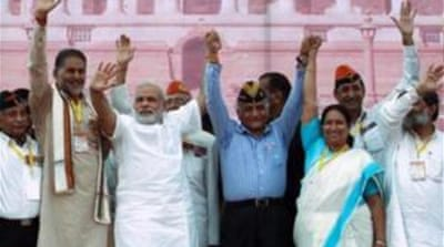 Many view Narendra Modi, third from left, as a tough and decisive leader [AFP]