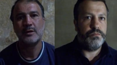 Murat Akpinar (left) and Murat Agca (right) were kidnapped on August 9 in Beirut [AFP]