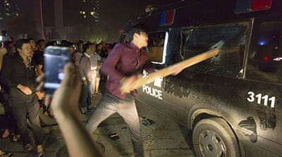 Residents in Yuyao smashed police vans and blocked a local TV vehicle [Reuters]