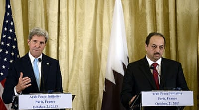 Kerry, left, and Qatar Foreign Minister Khaled al-Attiya addressed two-state solution for Palestine and Israel [AFP]