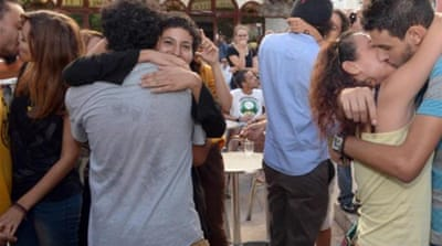 A 'kiss-in' held in Rabat protested the arrest of three teenagers for a Facebook photo of a kiss [EPA]