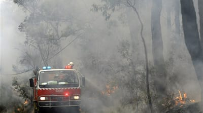 Australia races to contain bushfires