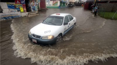 Many streets were flooded in Acapulco, Guerrero state, Mexico as Raymond passes close to the Pacific coast [AFP]