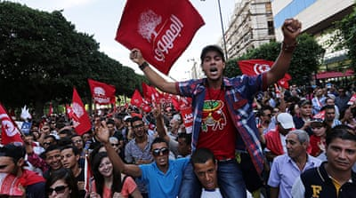 Tunisia protesters urge government to resign