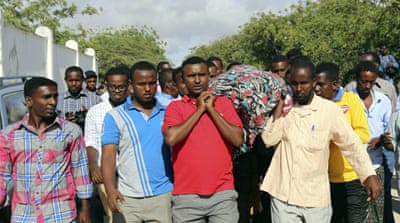 Family and friends pray at the funeral of Mohamed Mohamud Tima-ade [Reuters]