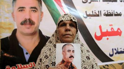 Palestinian prisoner Jamil Nabi Annatsheh is welcomed by his relatives in Hebron in August 2013 [EPA]