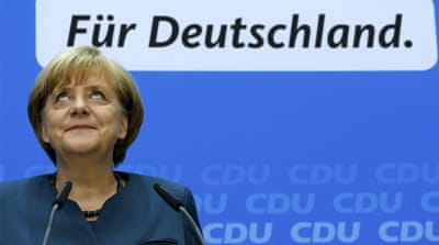 Merkel, rivals to continue coalition talks