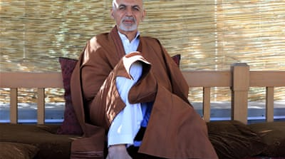 A campaign poster of presidential candidate Ashraf Ghani Ahmadzai (L) in 2009 in Kandahar [Getty Images]