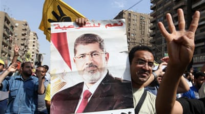 Mohamed Morsi (right), Egypt's first elected president, was toppled by the military in July [AFP]