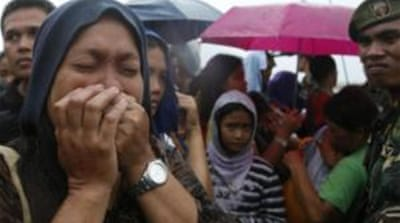 Philippine typhoon relief hampered by delays