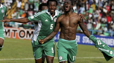 Victor Moses, right, of Nigeria, celebrates after scoring a goal against Ethiopia in Calabar  [Reuters]