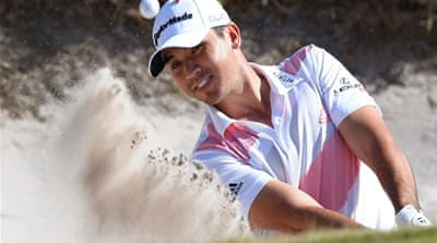 Jason Day hits out of a bunker during the Golf World Cup tournament played at the Royal Melbourne course [AFP]