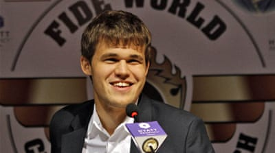Carlsen, right, beat Anand in Chennai in chess's most highly anticipated title match in decades [Reuters]