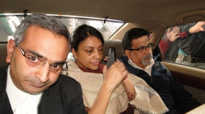 Rajesh (R) and his wife Nupur (C) were convicted on Monday of murdering their teenage daughter [Getty Images]