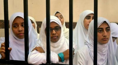 Twenty-one female supporters of Morsi were sentenced to 11 years in prison [AP]