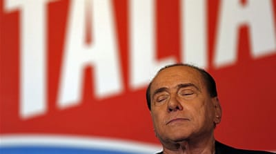 Berlusconi pledges to stay in politics