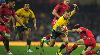 Wallabies fly half Quade Cooper evades the tackle of Wales' Leigh Halfpenny [Getty Images]