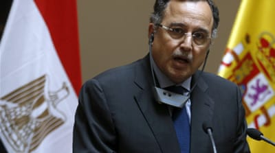 Speaking in Spain, Fahmy said the banned Muslim Brotherhood's political arm could participate in elections [Reuters]