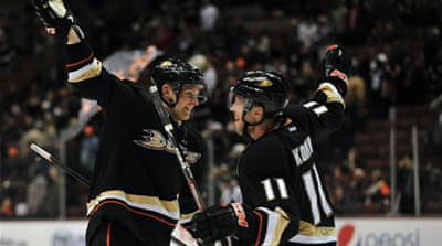 Anaheim's Corey Perry, left, and Saku Koivu celebrate the 5-2 victory against the New York Islanders [Reuters]