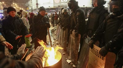 Streets were blocked as protesters rallied outside the presidential administration building in Kiev [Reuters]