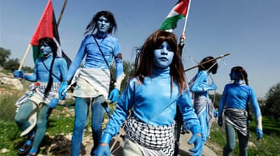 Palestinians dressed as Avatar's Navi, protest against Israel's separation wall [Reuters]