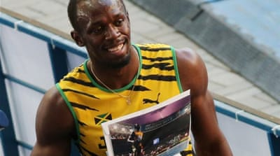 Usain Bolt will be taking on a Metrobus in an 80-yard dash on Saturday [AFP]
