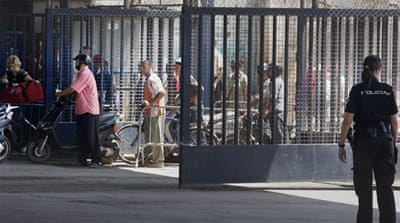 Spain started constructing barbed wire fences along Melilla's 11-km border last month [AP]