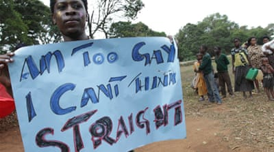 Gay and lesbian activists attend Uganda's first gay pride parade in Kampala last year [EPA]