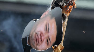 Some South Koreans burned effigies of former North Korean leader Kim Jong-il earlier this week [EPA]