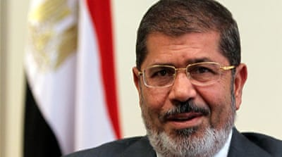 Egypt's Morsi faces trial for prison break