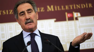 Former minister Ertugrul Gunay accused the government of 'arrogance' as he announced his resignation [Reuters]