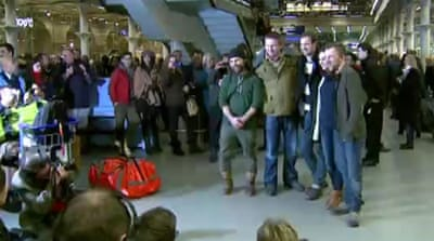Freed Greenpeace activists arrive home