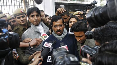 Kumar Vishwas, right, is a close aide of Delhi Chief Minister Arvind Kejriwal [AP]