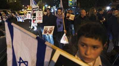 Dozens of demonstrators gathered outside Prime Minister Benjamin Netanyahu's residence [EPA]