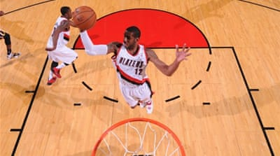 Trail Blazer LaMarcus Aldridge grabs a rebound against the Indiana Pacers  [AFP]