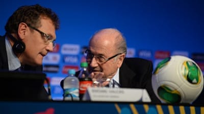 Jerome Valcke confers with Joseph Blatter  as they announce the World Cup procedure in Brazil [Reuters]