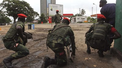 Gunfire broke out at the airport, a military base, and the state television station RTNC in Kinshasa [Reuters]