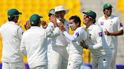 Pakistan players celebrate after he dismissing Sri Lanka's Dinesh Chandimal [AFP]