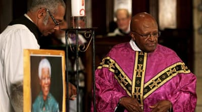 Archbishop Desmond Tutu had a close friendship with the late Mandela [EPA]