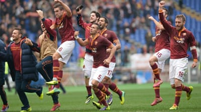 Roma's players celebrate winning their Italian Serie A football match against Fiorentina [AFP]
