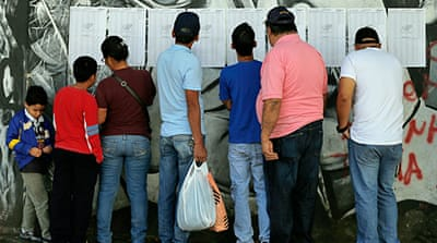 Electoral officials say the voter turn-out was 59 percent [AP]