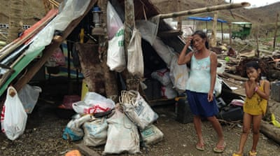 Corruption, natural disasters and poverty continue to be problems for the Philippines  [AFP]