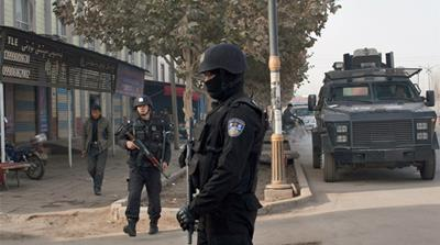 Security forces have a heavy presence in China's far-west Xinjiang province [Andrey Kovalenko/Al Jazeera]
